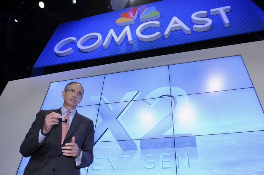 FILE - This June 11, 2013 file photo shows Comcast Corp. CEO Brian Roberts during The Cable Show 2013 convention in Washington. Comcast, the nation's biggest cable colossus, plans to swallow runner-up titan Time Warner Cable. This $45 billion deal would give Comcast 30 million subscribers in 43 of the nation's top 50 markets and about 30 percent of pay TV customers. (AP Photo/Susan Walsh, File)