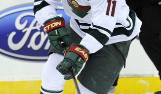 Minnesota Wild's Zach Parise skates in on a breakaway during the first period of an NHL hockey game against the New Jersey Devils, Thursday, March 20, 2014, in Newark, N.J. (AP Photo/Bill Kostroun)