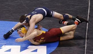 Penn State's Matt Brown maneuvers above Iowa State's Tanner Weatherman in a 174-pound match in the second round of the NCAA Division I wrestling championships in Oklahoma City, Thursday, March 20, 2014. Brown won the match. (AP Photo/Sue Ogrocki)