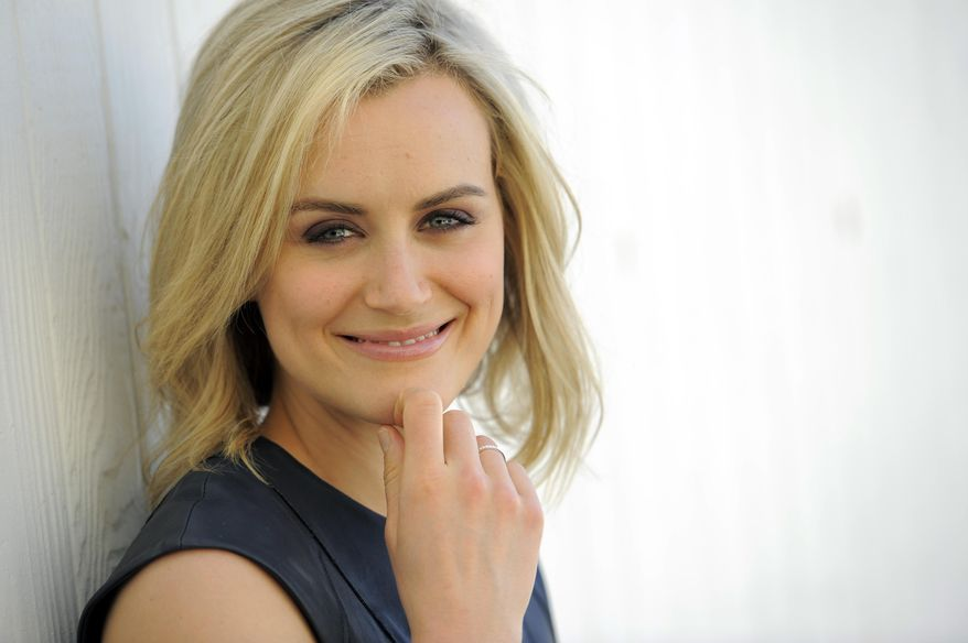 "In this Monday, March 17, 2014 photo, actress Taylor Schilling poses for a portrait in Los Angeles. Schilling stars as Piper Chapman in the Lionsgate television series, ""Orange Is the New Black."" Season two debuts on Netflix on June 6, 2014. (Photo by Chris Pizzello/Invision/AP)"