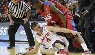 Ohio State's Aaron Craft (4) and Dayton's Jordan Sibert (24) fight for control of the ball during the first half of a second-round game in the NCAA college basketball tournament in Buffalo, N.Y., Thursday, March 20, 2014. (AP Photo/Bill Wippert)