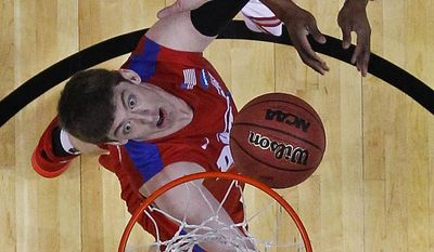 Dayton's Matt Kavanaugh, bottom, and Ohio State's Lenzelle Smith Jr. vie for a rebound during the first half of a second-round game in the NCAA college basketball tournament in Buffalo, N.Y., Thursday, March 20, 2014. (AP Photo/Bill Wippert)