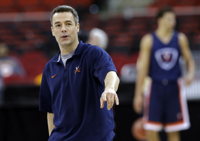 Virginia head coach Tony Bennett directs his team during practice at the NCAA college basketball tournament in Raleigh, N.C., Thursday, March 20, 2014. Virginia plays Coastal Carolina in a second-round game on Friday. (AP Photo/Gerry Broome)