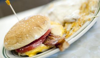 FILE - In this Wednesday, June 26, 2013, file photo, a breakfast sandwich is photographed at the Triple XXX restaurant in West Lafayette, Ind. Breakfast is now being served with a dose of sticker shock. The cost of morning staples like bacon, coffee and orange juice is surging on a host of global supply problems, from drought in Brazil to disease on U.S. pig farms.  (AP Photo/Journal & Courier, Brent Drinkut)