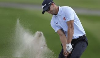 Adam Scott, of Australia, blasts out of the sand trap on the seventh hole during the second round of the Arnold Palmer Invitational golf tournament at Bay Hill Friday, March 21, 2014, in Orlando, Fla. (AP Photo/Chris O'Meara)