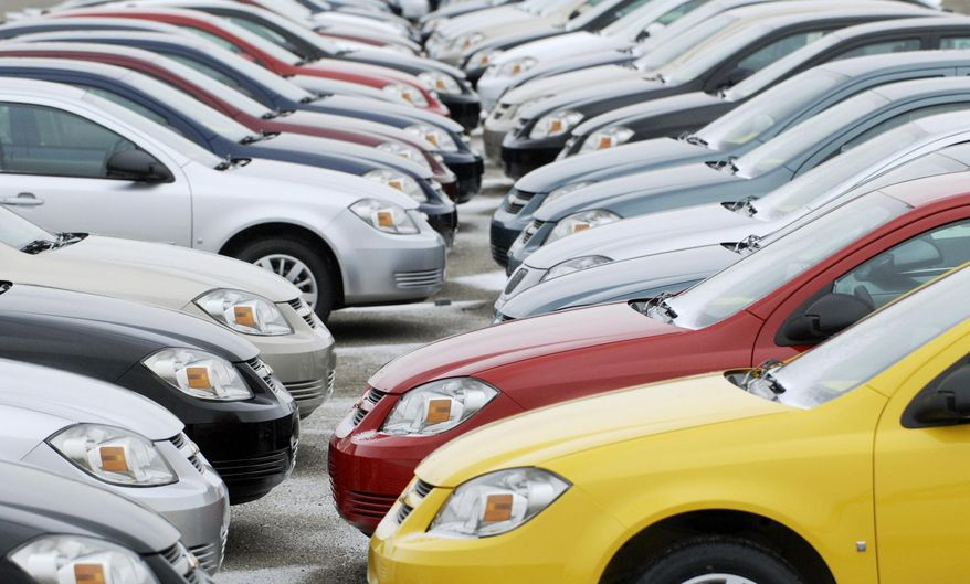 FILE - In this Friday, Dec. 12, 2008, file photo, rows of cars sit on the lot at the Lordstown, Ohio The families of three teenagers killed or injured in a 2006 Wisconsin car crash are suing General Motors, alleging that the company was negligent in designing its small cars and committed fraud by not disclosing facts about the defects. (AP Photo/Mark Stahl)