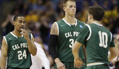 Cal Poly guard Jamal Johnson (24), forward Brian Bennett (34) and guard Ridge Shipley (10) gather between plays against Wichita State during the second half of a second-round game in the NCAA college basketball tournament Friday, March 21, 2014, in St. Louis. (AP Photo/Charlie Riedel)