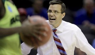 Nebraska coach Tim Miles yells at an official during the first half of a second-round game against Baylor in the NCAA college basketball tournament Friday, March 21, 2014, in San Antonio. (AP Photo/Eric Gay)