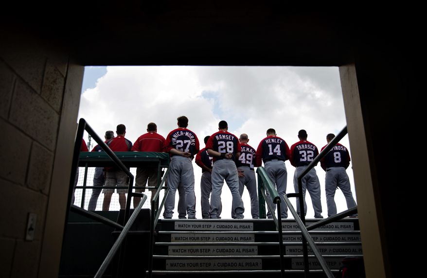 Washington Nationals players stand for the National Anthem before the start of an exhibition spring training baseball game against the St. Louis Cardinals, Friday, March 21, 2014, in Jupiter, Fla. (AP Photo/David Goldman)