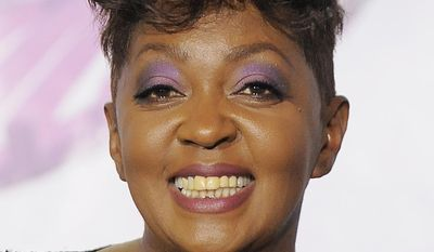FILE- In this  June 26, 2011 file photo, Anita Baker poses backstage at the BET Awards in Los Angeles. An arrest warrant has been issued for Grammy Award-winning singer Anita Baker. A company says Baker owes it $15,000 for work done on her Grosse Pointe, Mich., home. (AP Photo/Chris Pizzello, File)