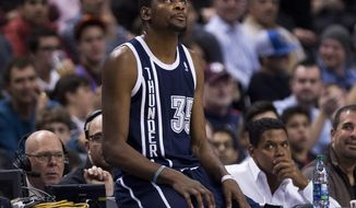Oklahoma Thunder forward Kevin Durant looks up after being called on a technical foul against the Toronto Raptors during the first half of an NBA basketball game in Toronto on Friday, March 21, 2014. (AP Photo/The Canadian Press, Nathan Denette)