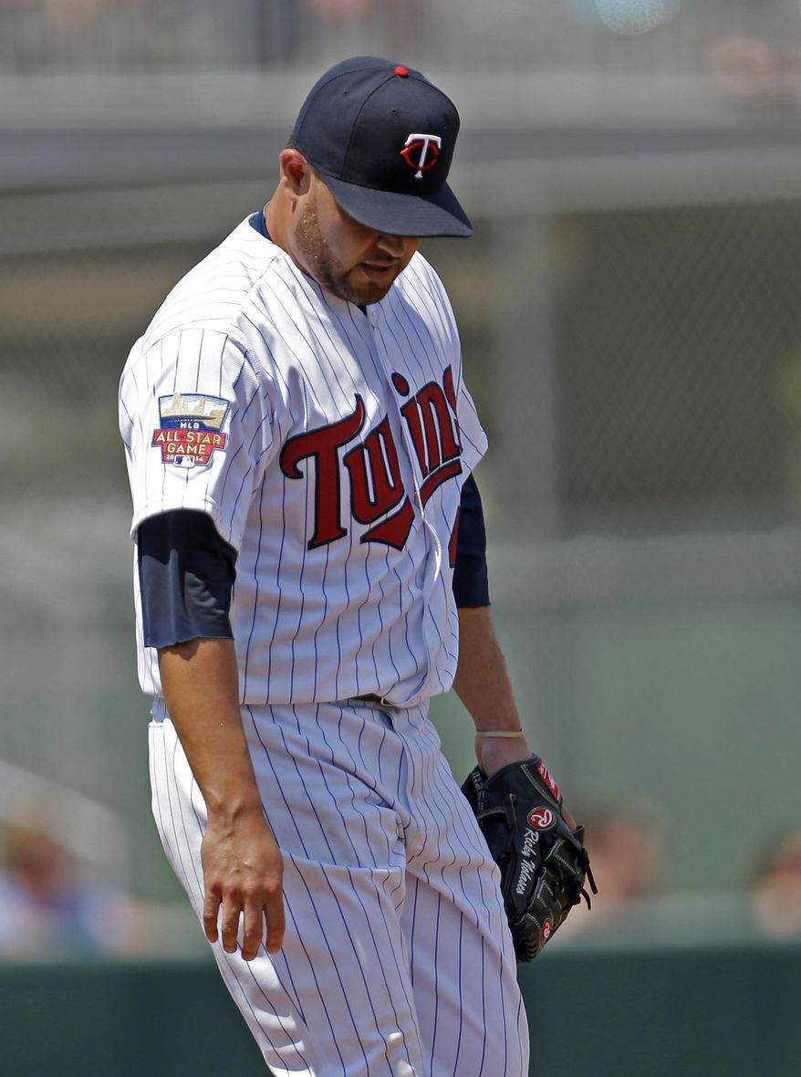 Minnesota Twins starting pitcher Ricky Nolasco (47) reacts after giving up a two-run homer to New York Mets' Taylor Teagarden in the first inning of a exhibition baseball game in Fort Myers, Fla., Friday, March 21, 2014. (AP Photo/Gerald Herbert)