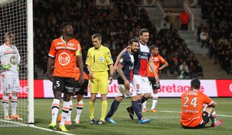 Paris Saint Germain's forward Ezequiel Lavezzi (22) and Thiago Motta (8) jubilate after Motta scored the first goal during their French League one soccer match against Lorient, in Lorient, western France, Friday, March 21, 2014. (AP Photo/David Vincent)