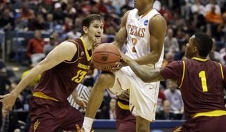 Texas' Demarcus Holland (2) is fouled by Arizona State's Jahii Carson (1) as Arizona State's Jordan Bachynski (13) watches during the first half of a second-round game in the NCAA college basketball tournament Thursday, March 20, 2014, in Milwaukee. (AP Photo/Jeffrey Phelps)