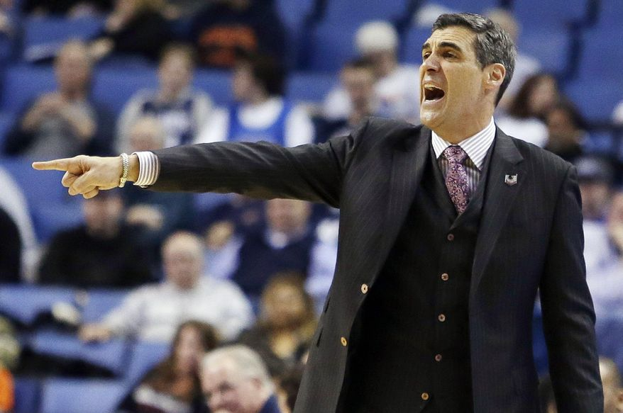Villanova head coach Jay Wright gestures during the second half of a second-round game against Milwaukee in the NCAA college basketball tournament in Buffalo, N.Y., Thursday, March 20, 2014. (AP Photo/Nick LoVerde)