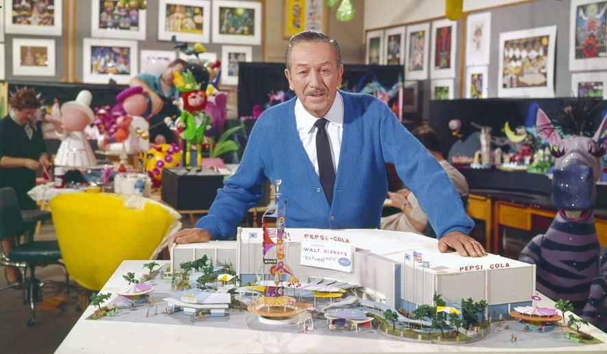 """This 1964 photo released by Disney shows Walt Disney with a model of the """"It's a Small World"""" attraction from the 1964 World's Fair. (AP Photo/Disney)"""