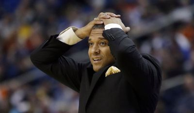 Milwaukee head coach Rob Jeter reacts to a call during first half of a second-round game against Villanova in the NCAA college basketball tournament in Buffalo, N.Y., Thursday, March 20, 2014. (AP Photo/Nick LoVerde)