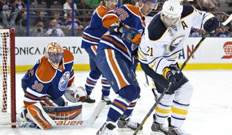 Buffalo Sabres' Drew Stafford (21) battles for the puck with Edmonton Oilers' Martin Marincin (85) as goalie Ben Scrivens (30) makes the save and Jeff Petry (2) defends during the first period of an NHL hockey game in Edmonton, Alberta, on Thursday, March 20, 2014. (AP Photo/The Canadian Press, Jason Franson)