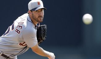 Detroit Tigers starting pitcher Justin Verlander throws during the first inning of a spring exhibition baseball game against the Atlanta Braves in Kissimmee, Fla., Friday, March 21, 2014. (AP Photo/Carlos Osorio)
