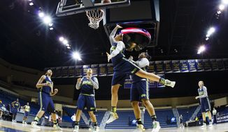 Notre Dame forward Natalie Achonwa shoots during practice at the NCAA women's college basketball tournament in Toledo, Ohio, Friday, March 21, 2014. Notre Dame plays Robert Morris in the first-round game on Saturday. (AP Photo/Rick Osentoski)