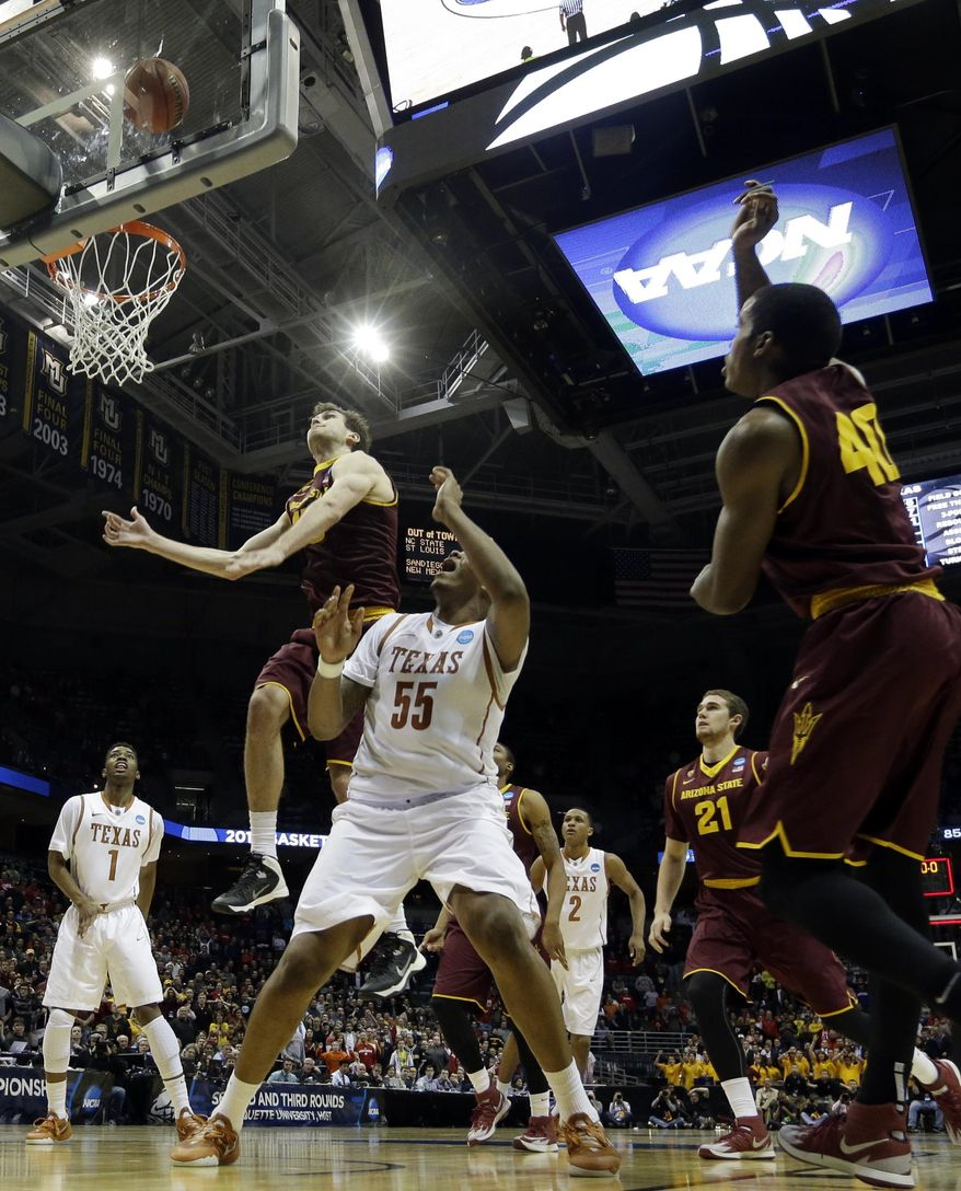 Texas center Cameron Ridley (55) watches his game winning shot against Arizona State during the second half of a second-round game in the NCAA college basketball tournament Thursday, March 20, 2014, in Milwaukee. Texas won 87-85. (AP Photo/Morry Gash)