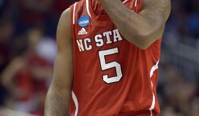 North Carolina State guard Desmond Lee (5) walks the court during overtime against Saint Louis in a second-round game in the NCAA college basketball tournament Thursday, March 20, 2014, in Orlando, Fla. Saint Louis won 83-80 in overtime. (AP Photo/Phelan M. Ebenhack)
