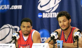 Dayton players,Vee Sanford, left,  and Devin Oliver speak during a news conference at the NCAA college basketball tournament in Buffalo, N.Y., Friday, March 21, 2014. Syracuse plays Dayton in a third-round game on Saturday. (AP Photo/The Buffalo News, Harry Scull Jr.) TV OUT; MAGS OUT; SALAMANCA PRESS OUT; TONAWANDA NEWS OUT
