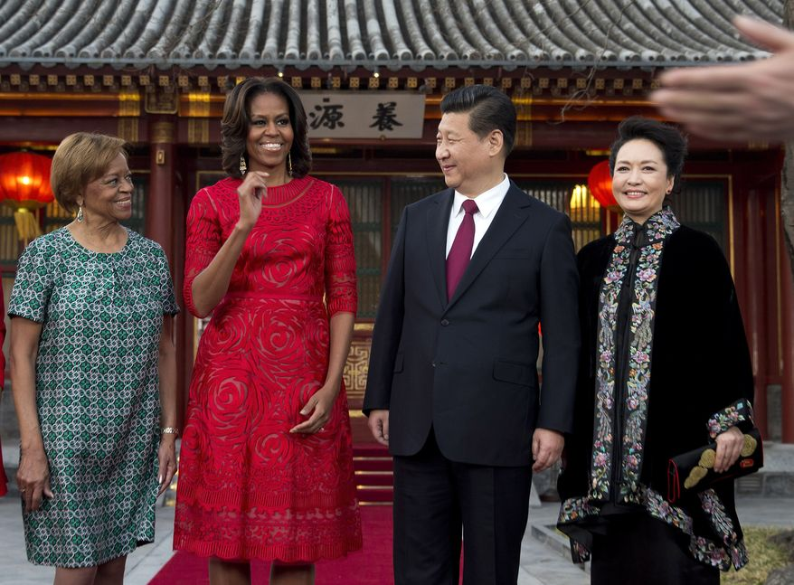 First lady Michelle Obama, second from left, her mother Marian Robinson, left, share a light moment with Chinese President Xi Jinping, second from right, at the Diaoyutai state guesthouse in Beijing in March. (AP Photo/Andy Wong, Pool)