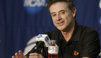 Louisville coach Rick Pitino speaks during a news conference at the NCAA college basketball tournament Friday, March 21, 2014, in Orlando, Fla. Louisville plays Saint Louis in a third-round game on Saturday. (AP Photo/John Raoux)