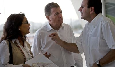 "Rio de Janeiro's Eduardo Paes, right, talks with Nawal El Moutawakel, head of the International Olympic Committee (IOC) Evaluation Commission, center, and International Olympic Committee (IOC) Executive Director for the Olympic Games, Gilbert Felli during a visit to the Olympic Park in Rio de Janeiro, Brazil, Thursday, March 20, 2014. With IOC officials in Rio de Janeiro on to monitor progress on the 2016 Olympics, the city's mayor acknowledged that work on a large cluster of venues is far behind schedule. Paes made his remarks as Nawal El Moutawakel reminded Rio officials that the recent Sochi Winter Olympics showcased ""meticulous planning."" She urged Rio organizers to meet deadlines and to explain clearly to the Brazilian public why it should back the games. (AP Photo/Silvia Izquierdo)"