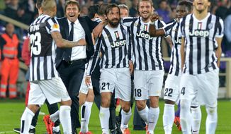 Juventus coach Antonio Conte, second from left, celebrates wit his players  at the end of an  Europa League, round of 16, return-leg soccer  match between Fiorentina and Juventus at the Artemio Franchi stadium in Florence, Italy, Thursday, March 20, 2014. Juventus won 1-0. (AP Photo/ Massimo Pinca)