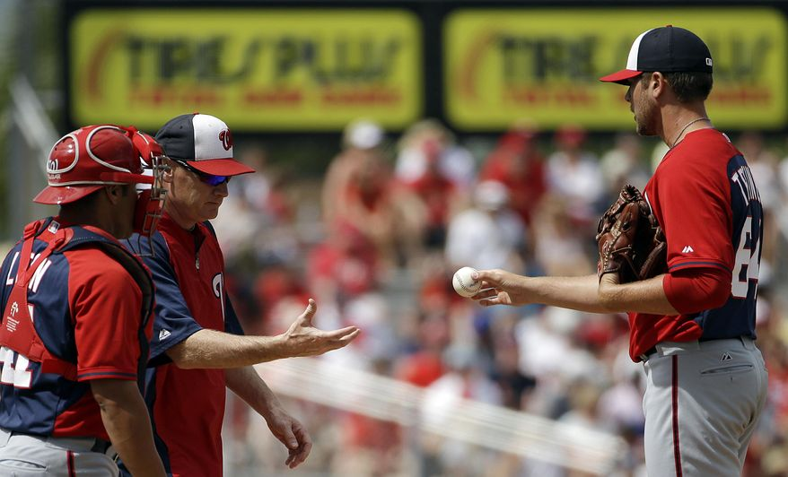 Washington Nationals relief pitcher Blake Treinen, right, is relieved by manager Matt Williams in the eighth inning of an exhibition spring training baseball game, Friday, March 21, 2014, in Jupiter, Fla. (AP Photo/David Goldman)