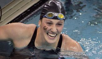 Missy Franklin, of California, celebrates after winning the 200-yard freestyle event at the NCAA Women's Division I Championships in Minneapolis, Friday March 21. 2014.(AP Photo/Andy Clayton-King)