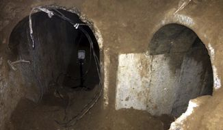 This undated photo released by the Israel Defense Forces on Friday, March 21, 2014, that they claim shows a tunnel dug from the Hamas-ruled Gaza Strip that stretches hundreds of meters (yards) inside Israel.  The Israeli military says it has discovered another tunnel — the biggest so far — dug from the Hamas-ruled Gaza Strip into Israel and says it was intended for attacks on soldiers and civilians. Hamas spokesman Abu Obeida blamed the tunnel's discovery on recent rains that exposed its opening. (AP Photo/Israeli Defense  Forces)