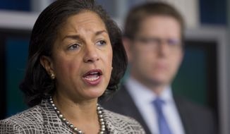 National Security Adviser Susan Rice, accompanied by White House press secretary Jay Carney, speaks during a briefing on President Barack Obama's upcoming trip to Europe and Saudi Arabia, Friday, March 21, 2014, in the Brady Press Briefing Room of the White House in Washington.    (AP Photo/Manuel Balce Ceneta)