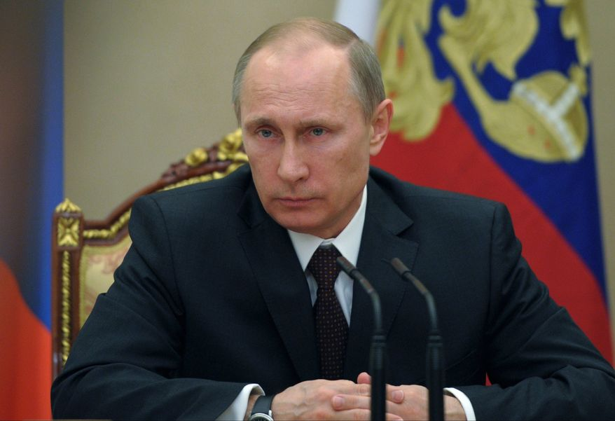 Russian President Vladimir Putin chairs a meeting with Security Council members in the Kremlin in Moscow, Russia, Friday, March 21, 2014. There is no need for Russia to further retaliate against U.S. sanctions, President Vladimir Putin said Friday as Russia's upper house of parliament endorsed the annexation of Crimea from Ukraine. (AP Photo/RIA-Novosti, Alexei Druzhinin, Presidential Press Service)