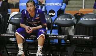 Northwestern State guard Janelle Perez watches from the bench in the second half of an NCAA women's college basketball first-round tournament game against, Tennessee Saturday, March 22, 2014, in Knoxville, Tenn. Tennessee won 70-46. (AP Photo/John Bazemore)