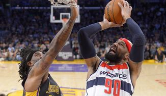 Washington Wizards forward Drew Gooden puts up a shot as Los Angeles Lakers forward Jordan Hill defends during the first half of an NBA basketball game, Friday, March 21, 2014, in Los Angeles. (AP Photo/Mark J. Terrill)