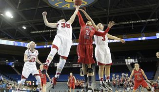 Fresno State's Moriah Faulk (25) fights for a rebound with Nebraska's Jordan Hooper (35) and Hailie Sample (3) during the first half of a first-round game in the NCAA women's college basketball tournament on Saturday, March 22, 2014, in Los Angeles. (AP Photo/Jae C. Hong)
