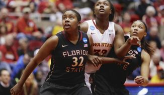 Iowa State's Fallon Ellis, center, is flanked by Florida State's Lauren Coleman (32) and Emiah Bingley, right, in the first half of a first-round game in the NCAA women's college basketball tournament in Ames, Iowa, Saturday, March 22, 2014. (AP Photo/Nati Harnik)
