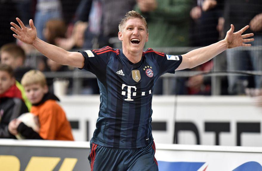 Bayern's Bastian Schweinsteiger celebrates after scoring  during  the German Bundesliga soccer match between FSV Mainz 05 and Bayern Munich in Mainz,  Germany, Saturday, March 22, 2014. (AP Photo/Martin Meissner)