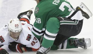 Dallas Stars center Vernon Fiddler (38) knocks Ottawa Senators right wing Ales Hemsky (83) to the ice keeping him from the puck during the second period an NHL Hockey game, Saturday, March 22, 2014, in Dallas. (AP Photo/LM Otero)