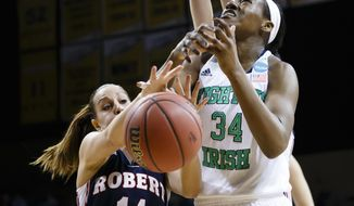 Robert Morris guard Ashley Ravelli (14) knocks the ball loose from Notre Dame forward Markisha Wright (34) during the first half in a first-round game in the NCAA women's college basketball tournament, Saturday, March 22, 2014, in Toledo, Ohio. (AP Photo/Rick Osentoski)