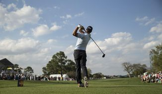 Adam Scott tees off on the 18th hole during the second round of the Arnold Palmer Invitational golf tournament at Bay Hill Friday, March 21, 2014, in Orlando, Fla. (AP Photo/ Willie J. Allen Jr.)
