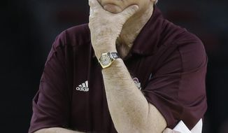 Texas A&M coach Gary Blair takes on a pensive pose as he watches during practice at the NCAA women's college basketball tournament  Saturday, March 22, 2014, in College Station, Texas. Texas A&M plays North Dakota in a first-round game on Sunday.  (AP Photo/Pat Sullivan)