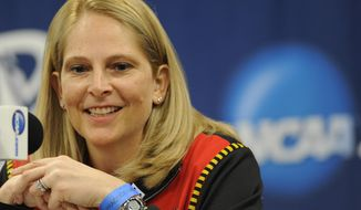Maryland head coach Brenda Fresesmiles during a news conference before the first round of the NCAA women's college basketball tournament, Saturday, March 22, 2014. in College Park, Md.(AP Photo/Gail Burton)