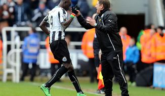 Newcastle United's Papiss Cisse, left, celebrates his goal with Head Coach John Carver, right, during their English Premier League soccer match against Crystal Palace at St James' Park, Newcastle, England, Saturday, March 22, 2014. (AP Photo/Scott Heppell)