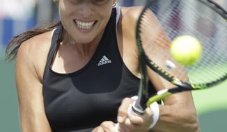 Ana Ivanovic, of Serbia, hits a return to Flavia Pennetta, of Italy, during a match at the Sony Open tennis tournament, Saturday, March 22, 2014, in Key Biscayne, Fla. (AP Photo/Luis M. Alvarez)