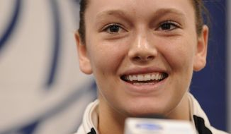 Army's Jen Hazlett smiles as she answers a question during a news conference at the NCAA women's college basketball tournament, Saturday, March 22, 2014. in College Park, Md. Army plays Maryland in a first-round game on Sunday. (AP Photo/Gail Burton)