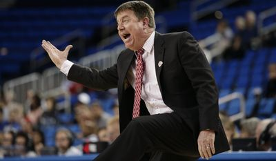 North Carolina State coach Wes Moore gestures to his players during the second half of a first-round game against BYU in the NCAA women's college basketball tournament on Saturday, March 22, 2014, in Los Angeles. BYU won 72-57. (AP Photo/Jae C. Hong)